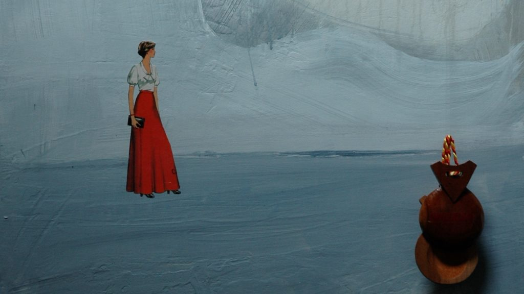 a blue and grey landscape painting with collaged female figure in a long red skirt . hanging in front of the painting is a pair of wooden castanets