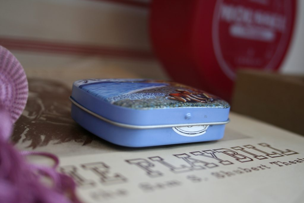 Small blue liquorice tin