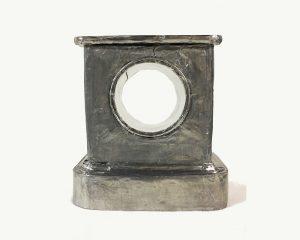 A photograph of a silver metallic clock case