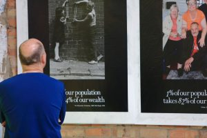 A man looking at posters on a wall